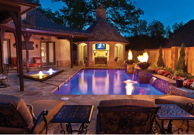 Fire features convert a backyard into an oasis. Source: Luxury Pools