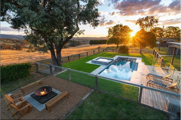 The clean lines of this rectangle pool blend nicely with their landscaping and firepit area. Source: Narellan Pools, Instagram