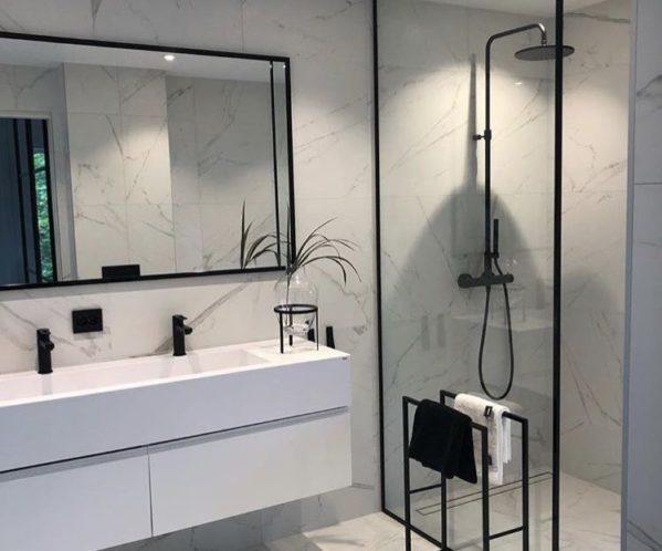 Modern bathroom with black fixtures.