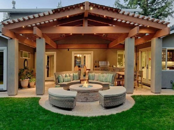 Patio with outdoor kitchen and fire pit,